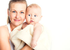 Portrait of beautiful smiling mother with a baby. Royalty Free Stock Photos