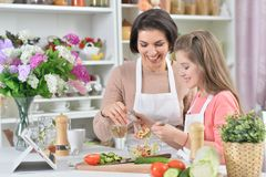 Portrait of a beautiful smiling mother and daughter stock photo