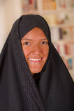Portrait of a beautiful smiling muslim girl wearing a hijab in a blurred background.  Royalty Free Stock Photo