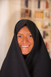 Portrait of a beautiful smiling muslim girl wearing a hijab in a blurred background.  Stock Image