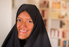 Portrait of a beautiful smiling muslim girl wearing a hijab in a blurred background.  Royalty Free Stock Photos