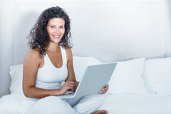 Portrait of beautiful smiling pregnant woman using laptop Royalty Free Stock Photo
