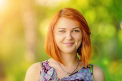 Portrait of beautiful smiling red-haired woman Royalty Free Stock Photo