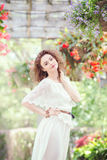 Portrait of beautiful smiling white Caucasian girl woman with long dark red brown hair, in white summer dress Royalty Free Stock Images