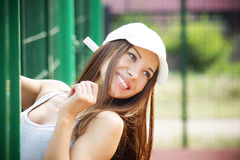 Portrait of beautiful smiling woman closeup. Girl in a white cap Royalty Free Stock Image