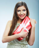 Portrait of beautiful smiling woman in evening dress hold red g Royalty Free Stock Images