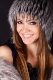 Portrait of a beautiful smiling woman in furs Royalty Free Stock Photography