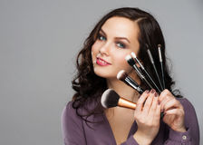 Woman with makeup brushes Royalty Free Stock Photo