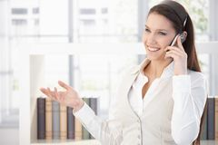 Portrait of beautiful smiling woman on phone Stock Image