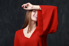 Portrait of a beautiful smiling woman in red dress Stock Photo