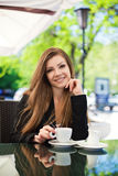 Portrait of beautiful smiling woman sitting in a cafe with laptop outdoor Stock Photography