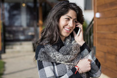 Portrait of beautiful smiling  woman talking on the phone outdoor Stock Images