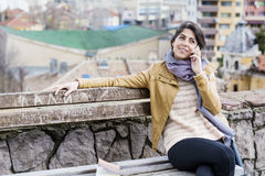 Portrait of beautiful smiling  woman talking on the phone outdoor Royalty Free Stock Image