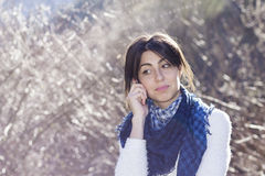 Portrait of beautiful smiling  woman talking on the phone outdoor Stock Photography
