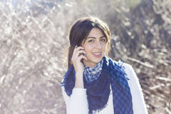 Portrait of beautiful smiling  woman talking on the phone outdoor Royalty Free Stock Photography