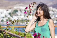 Portrait of beautiful smiling  woman talking on the phone outdoor Royalty Free Stock Photo