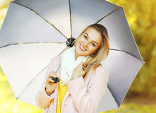 Portrait of beautiful smiling woman with umbrella in autumn Royalty Free Stock Photo