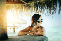 Portrait of beautiful smiling woman under parasol at tropical island Royalty Free Stock Images