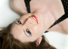 Portrait of Beautiful Smiling Woman Upside Down. Portrait of Beautiful Smiling Woman Lying Upside Down Stock Image