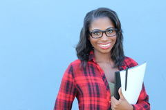 Portrait beautiful smiling young african woman with folder and glasses - Stock image Stock Photography