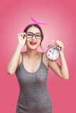 Portrait of a beautiful smiling young asian woman showing alarm Royalty Free Stock Photo