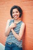 Portrait of beautiful smiling young hipster latin hispanic girl woman with short hair bob Stock Photo