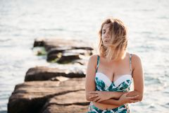 Portrait of beautiful smiling young woman in bikini on beach. Female model posing in swimsuit on sea shore. Summer holidays, stock photos