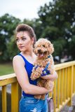 Teenager girl with red poodle stock photos