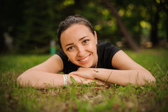 Portrait of beautiful smiling young woman in nature Stock Image