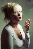 Portrait of beautiful smoking woman Royalty Free Stock Images