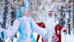 Portrait of beautiful Snow Maiden Laughing at camera and Father Frost coming towards her stock video footage