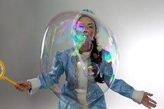 Portrait beautiful snow maiden with soap bubbles Stock Images