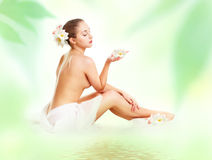 Portrait of a beautiful spa girl  with flowers Royalty Free Stock Photography