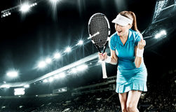 Portrait of beautiful sport woman tennis player with a racket. Portrait of beautiful girl tennis player with a racket on black background with lights royalty free stock photography