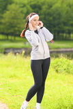 Portrait of Beautiful Sportive Woman Listening to Music Outdoor Royalty Free Stock Photos