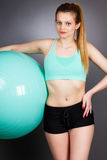 Portrait of a beautiful sports woman holding pilates ball ready Royalty Free Stock Photos