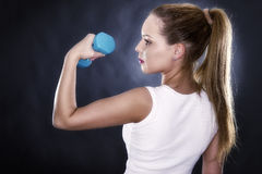 portrait of a beautiful sporty muscular woman Royalty Free Stock Images