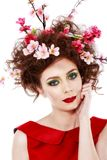 Portrait of a beautiful spring girl wearing flowers in hair. Stu Royalty Free Stock Photos