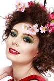 Portrait of a beautiful spring girl wearing flowers in hair. Stu Stock Photography