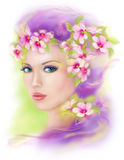 Portrait of a beautiful spring girl wearing flowers hat. Stock Photo