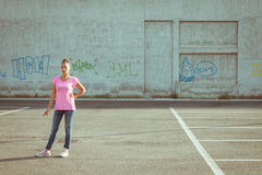 Portrait of a beautiful standing in parking lot Royalty Free Stock Photo