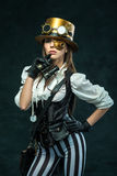 Portrait of a beautiful steampunk girl with binoculars Stock Photos