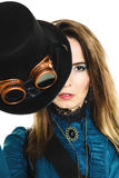 Portrait of beautiful steampunk woman isolated. Portrait of beautiful elegant steampunk retro woman covering part of her face with hat studio shot isolated on royalty free stock photography