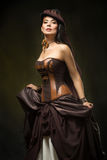 Portrait of a beautiful steampunk woman. Over dark background Stock Photography