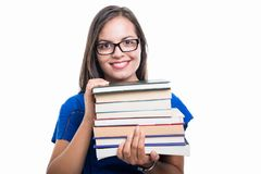 Portrait of student girl holding books and smiling Royalty Free Stock Photo