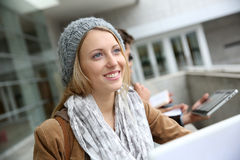 Portrait of beautiful student girl using tablet Royalty Free Stock Photography