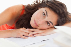 Portrait of a beautiful student head on her homeworks Royalty Free Stock Photos