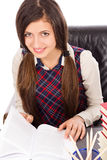 Portrait of a beautiful student reading at desk Royalty Free Stock Images