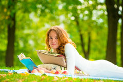 Portrait of a beautiful student in a summer park Royalty Free Stock Photos
