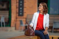 Portrait of a beautiful stylish business woman outdoors Royalty Free Stock Photo